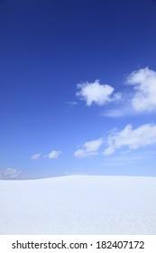 Blue sky and snowy field