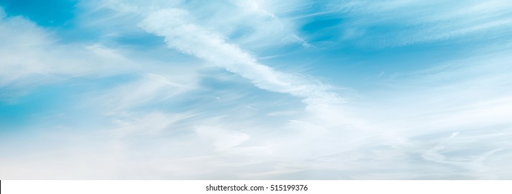 Blue sky in the soft white clouds. Natural cloudscape background