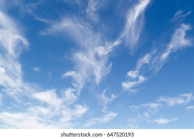 blue sky with Spindrift clouds