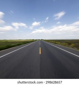 Blue sky straight road