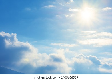 blue sky with sun and clouds. beautiful bright nature scenery