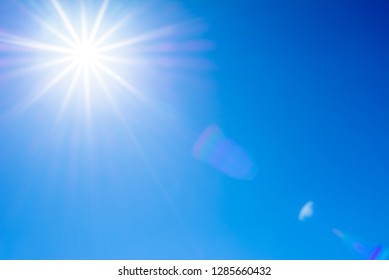 Blue sky and sun with flare