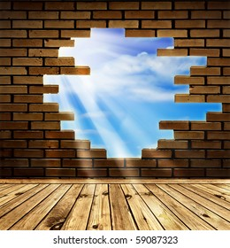 blue sky with sunlight  through the hole in the brick wall of room with wooden floor