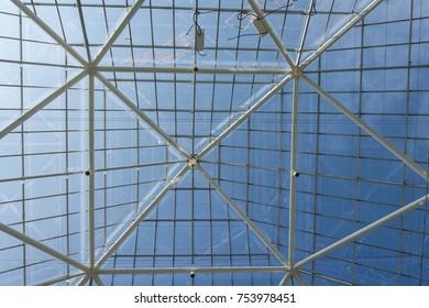 Blue sky through greenhouse roof