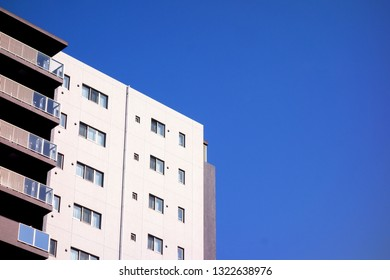 The blue sky and the top of the building