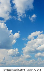 Blue sky vertical background with white clouds. Blue clear sky panorama with cloud closeup.