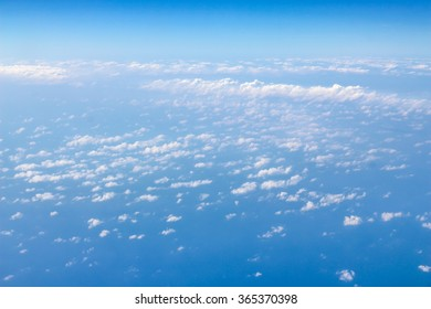 Blue sky view from above with clouds