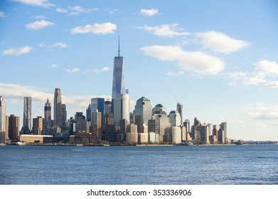 Blue sky view of the Downtown Manhattan skyline from across the Hudson River in New Jersey