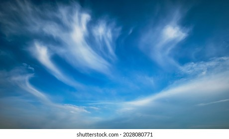 Blue sky with whie Cirrus clouds background texture