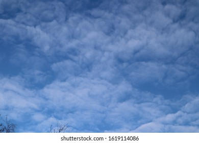 Blue sky with white alto cumulus clouds