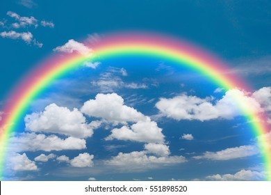 Blue sky and white cloud with rainbow background.