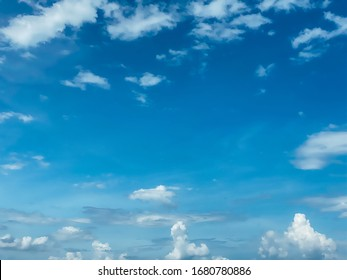 Blue sky with white clouds background. Clear sunny day, with scattered, beautiful clouds in a clear blue sky