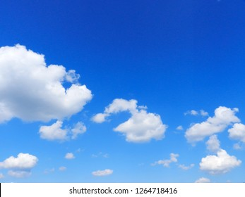 Blue sky with white clouds. Beautiful sky background. Clear day and good weather.