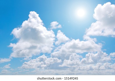 Blue sky with white clouds and bright Sun light