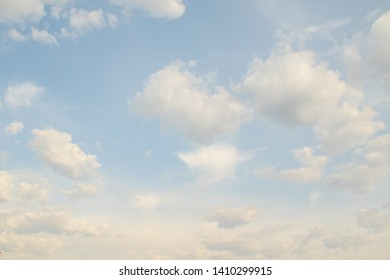 Blue sky with white clouds. Clear day sky background.