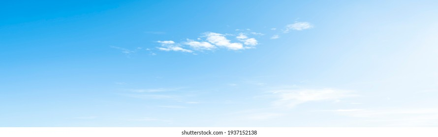 Blue sky and white clouds floated in the sky on a clear day with warm sunshine combined with cool breeze blowing against the body resulting in a miraculous refreshing like paradise.
