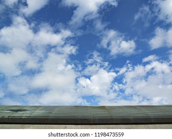 Blue sky and white clouds on the roof