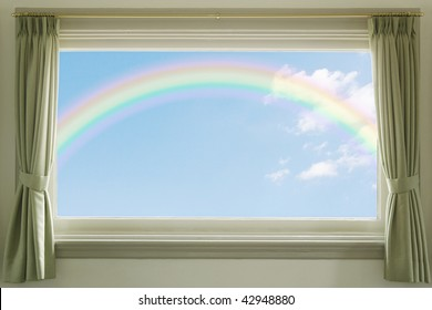 Blue sky with white clouds and a rainbow through the window