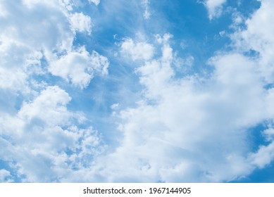 Blue sky and white clouds. Clouds texture. Nice sunny sky. A positive picture