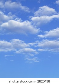 Blue sky with white clouds - vertical image