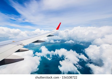Blue sky and white  clouds view from porthole airplane