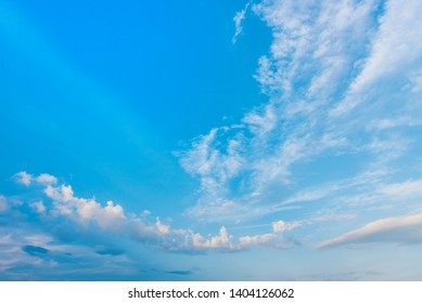 blue sky and white clouds.Freshness of the new day. Bright blue background. Relaxing feeling like being in the sky.