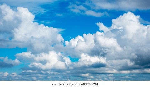 The blue sky with the white cumulonimbus clouds in the rainy season.
