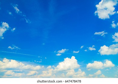 blue sky in the white fluffy clouds