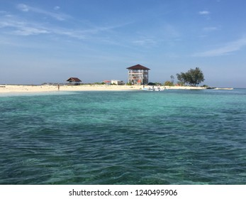 Blue sky, white sand beach & clear water beach in Kodingareng Keke island, South Sulawesi Indonesia