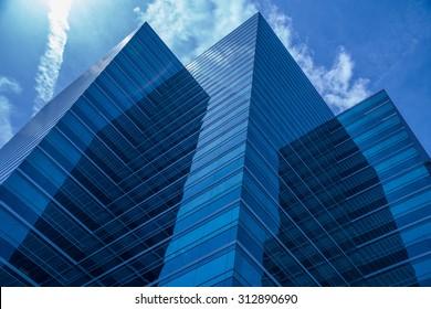 Blue Skyscraper Jets into the sky