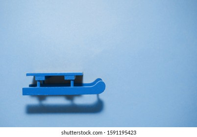 Blue sled on blue background.Holidays concept. Top view. Flat lay.