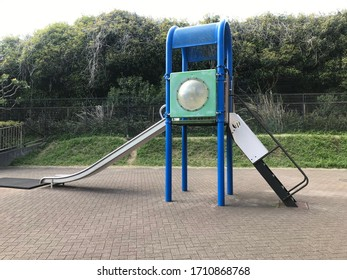 a blue slide on the playground