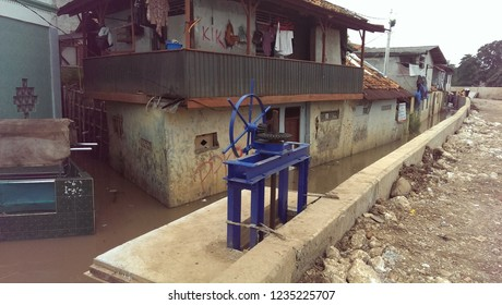 blue sluice on the side of the river