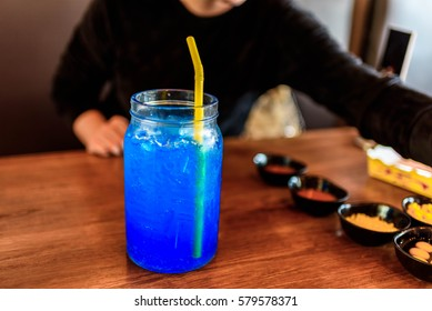 blue slush ice drink in glass
