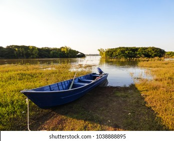 Blue small boat by the Uruguay river, natural border between Brazil and Argentina