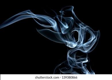 Blue smoke composing to Jinn head on the black background