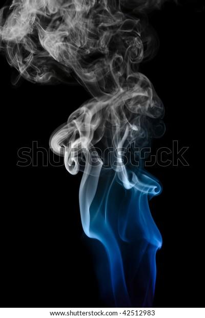 Blue smoke isolated on a black background.