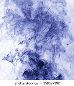 blue smoke on a white background. inversion