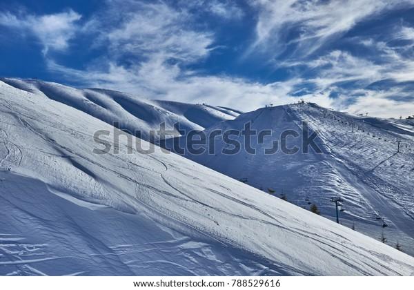 Blue snow on blue sky