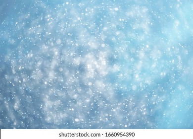 blue snowfall bokeh background, abstract snowflake background on blurred abstract blue