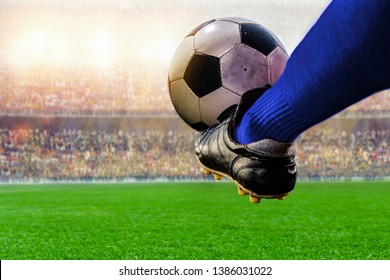 blue soccer player kicking ball action in the stadium