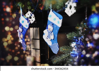 Blue socks for gifts above the fireplace on Christmas