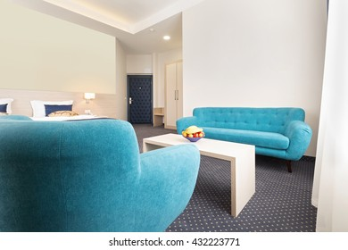 Blue sofa and armchair in hotel room
