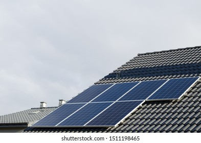 Blue solar panels on the roof of a house
