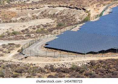Blue solar panels at photovoltaics power station farm, future innovation energy concept, clear blue sky background, Granadilla, Tenerife