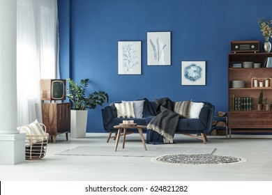 Blue spacious room with wooden old fashioned furniture