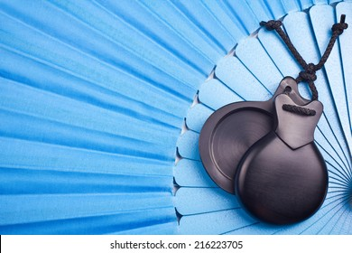 Blue Spanish flamenco fan with black castanets