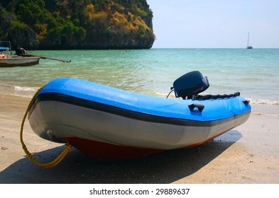 blue speed boat inflatable on beach