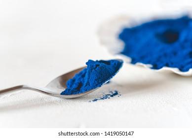Blue Spirulina algae powder, healthy dietary supplement.
