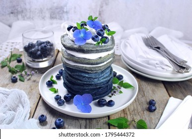 Blue Spirulina Pancakes with Coconut Whipped Cream, Blueberries & Hydrangea Flowers - Vegan
